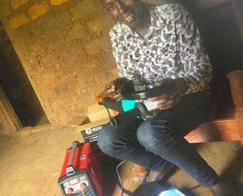 Derrick with his new welding machine