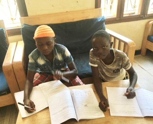 Two former street children studying hard