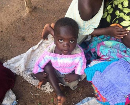 Donated jumpers for children in Uganda