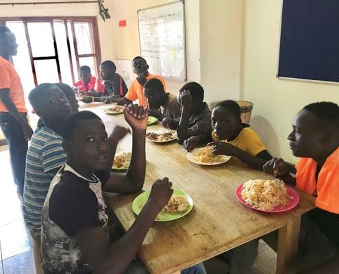 Former street boys eating well