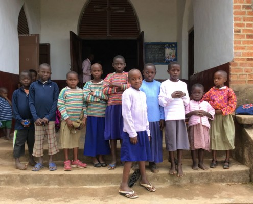 Group of children receiving new jumpers