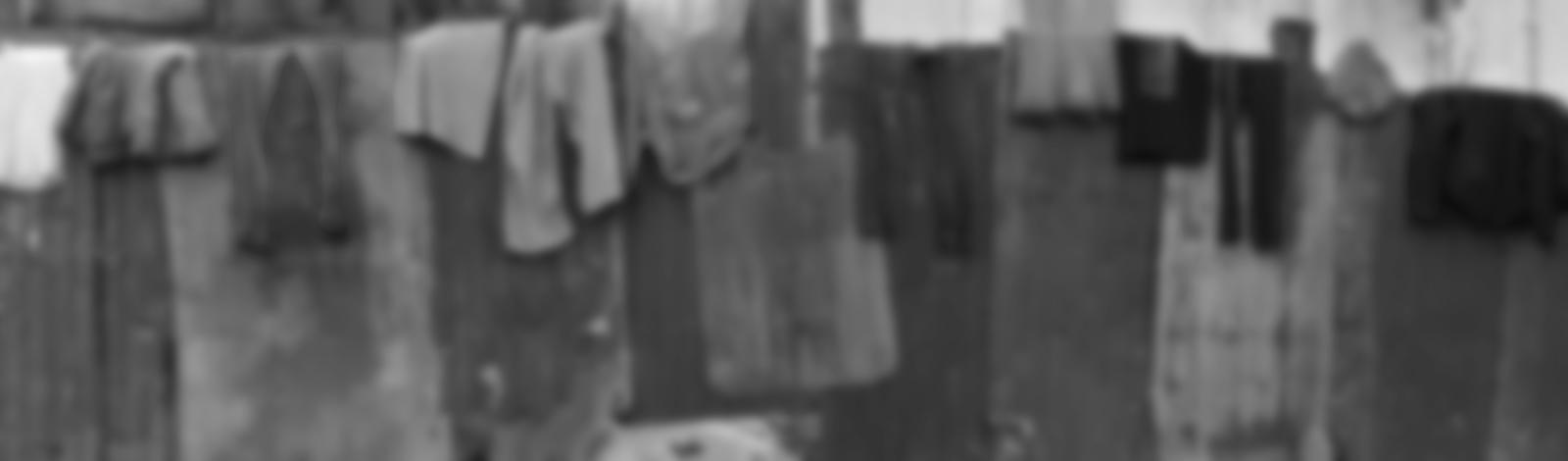 Background image of tin building shacks