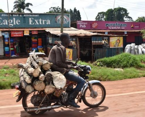 Boda boda bike carrying timber