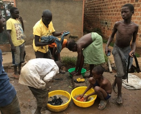 A group of street children washing clothes