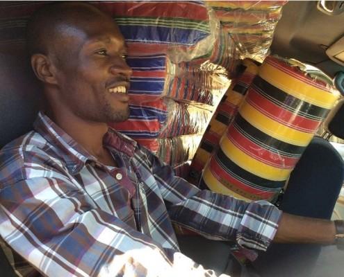 Bob delivering mattresses in the car