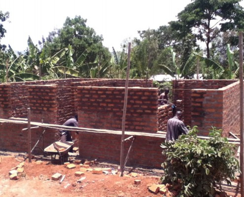 Workers building the new house