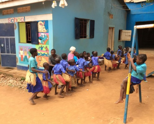 The children dancing for Jane