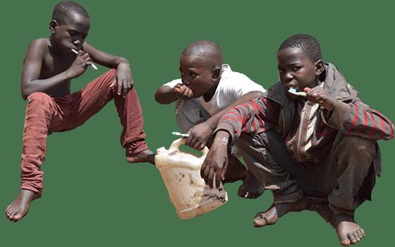 Homeless street children washing their teeth