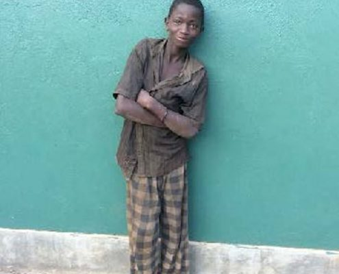 Street boy Godfrey arrives