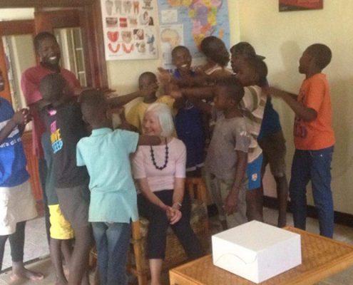 Street children welcoming Jane back