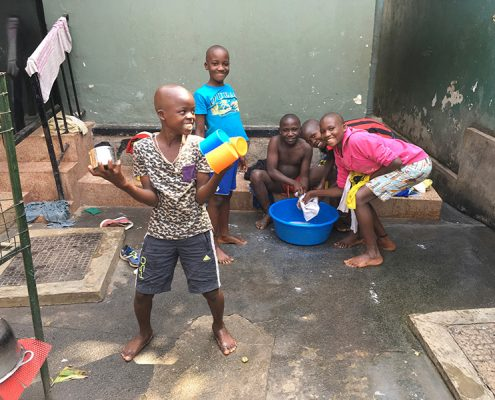 Street boys cleaning and having fun