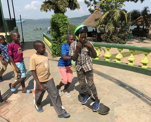 Street children playing with a skateboard