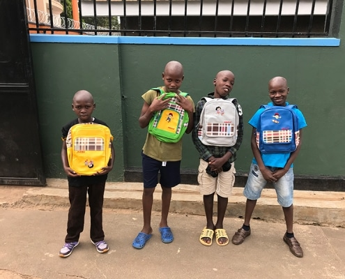 Four of our street children with new bags