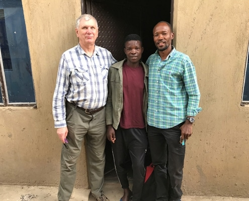 One of our street boys with two helpers