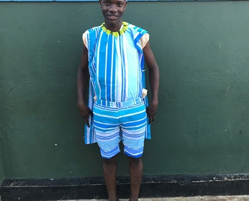 One of our boys in clothes he made