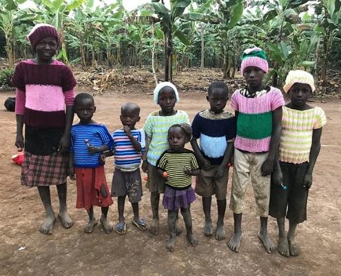 Ugandan children wearing donated jumpers
