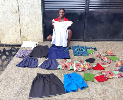 A street boy with his home-made clothes