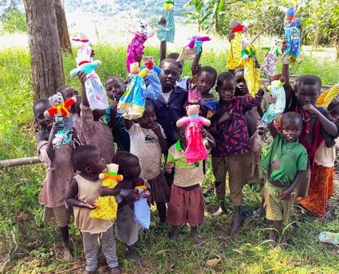Donated teddies for Ugandan village children