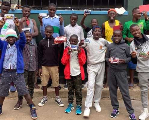Street children with donated Christmas gifts