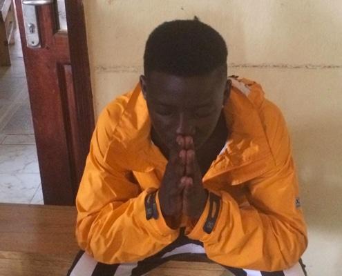 A street boy praying