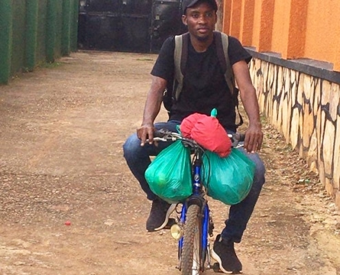 Shadrach on our charity's bicycle