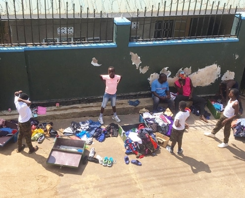 Ugandan street children sorting out their clothes