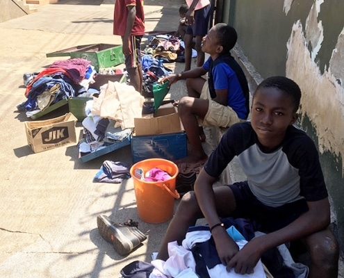 A street child organising his clothes