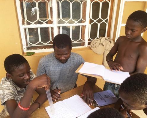 Boys in Kampala studying during lockdown