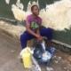 A street boy washing his clothes
