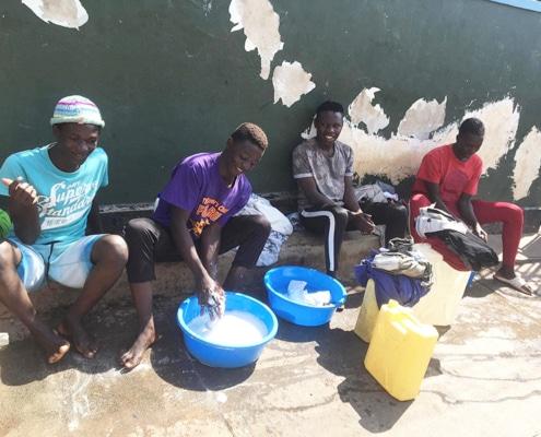 Street children washing their clothes