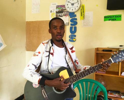Shadrach playing on guitar