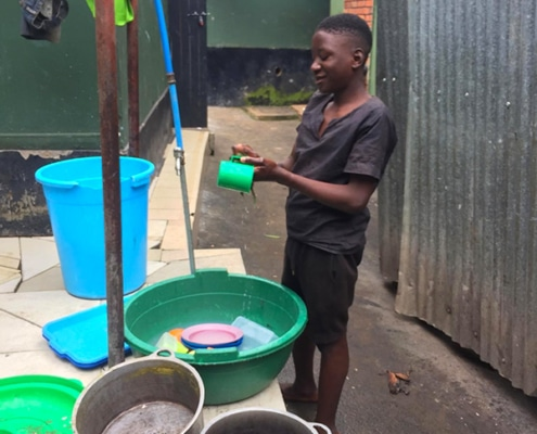 One of our street children washing up