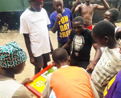 Street boys playing ludo