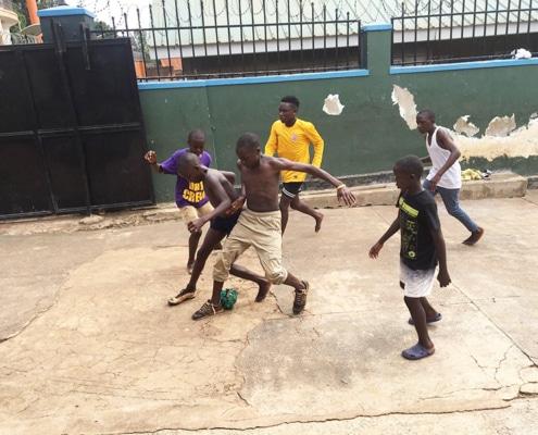 Street children playing football