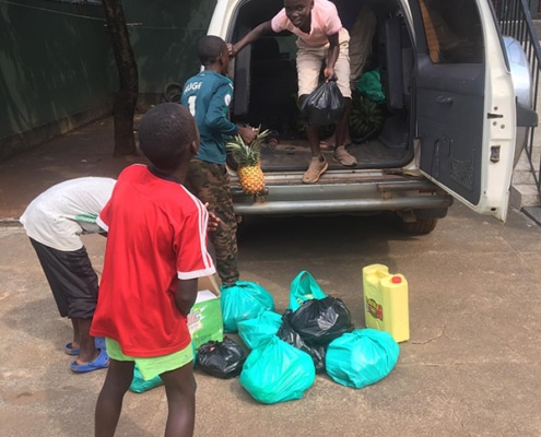 Street children help with the shopping