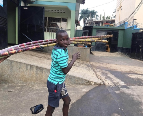 One of our street boys with donated sugar cane