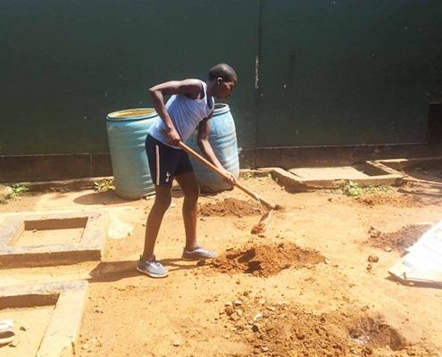Former street child gardening