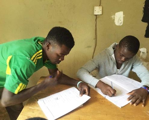 Two boys doing schoolwork