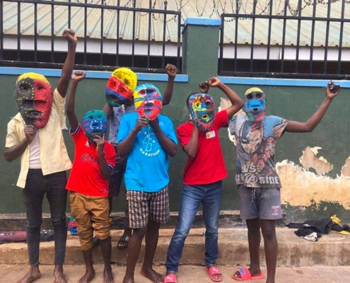 Street children with painted masks