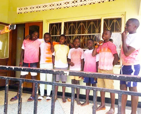 Former street children with new T-shirts