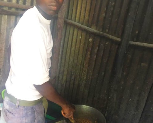 One of our boys cooking