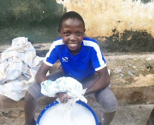 One of our boys washing his clothes