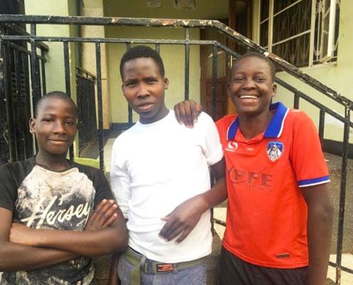 Three former street boys