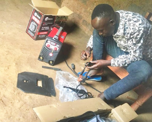 A former street boy setting up his tools